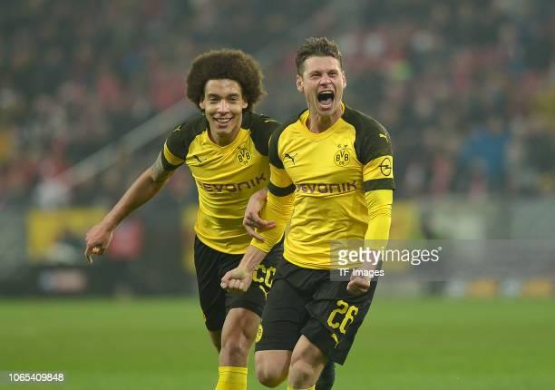 Lukasz Piszczek of Borussia Dortmund celebrates after scoring his team`s second goal with team mates during the Bundesliga match between 1 FSV Mainz...
