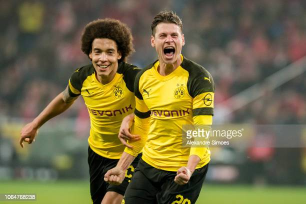 Lukasz Piszczek of Borussia Dortmund celebrates scoring the winning goal during the Bundesliga match between 1. FSV Mainz 05 and Borussia Dortmund at...