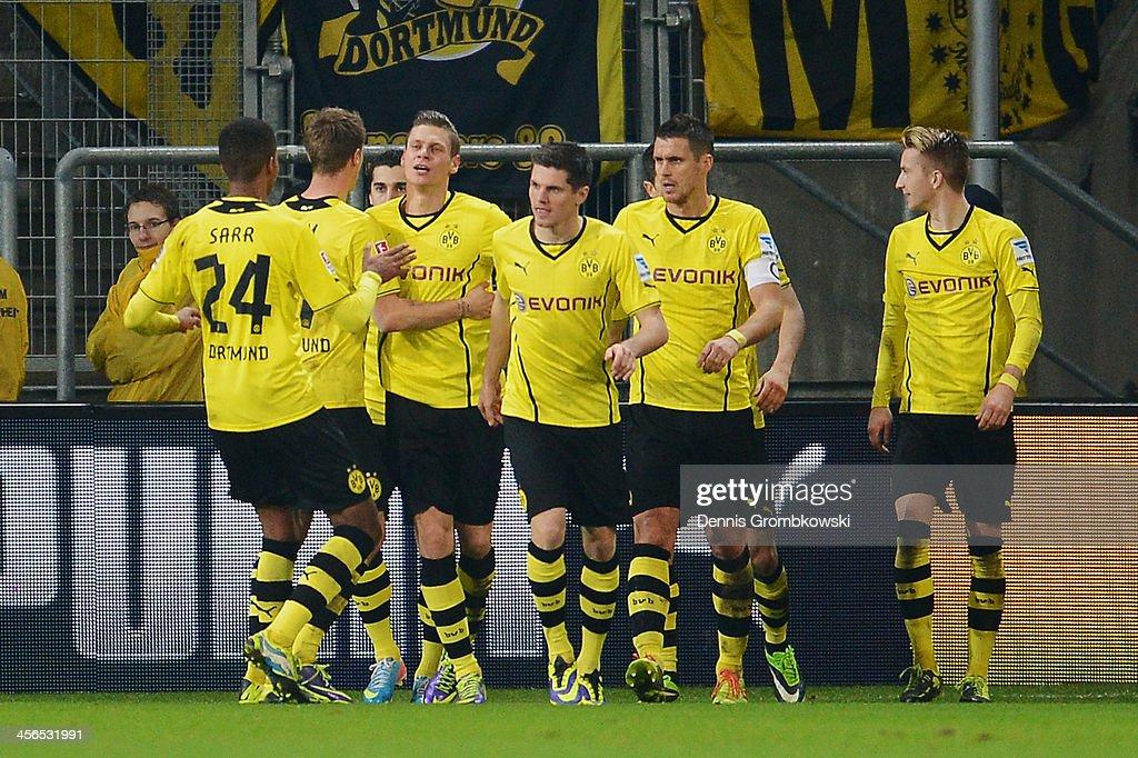 Lukasz Piszczek of Borussia Dortmund celebrates with teammates after scoring his team's second goal during the Bundesliga match between 1899 Hoffenheim and Borussia Dortmund at Rhein-Neckar-Arena on December 14, 2013 in Sinsheim, Germany.