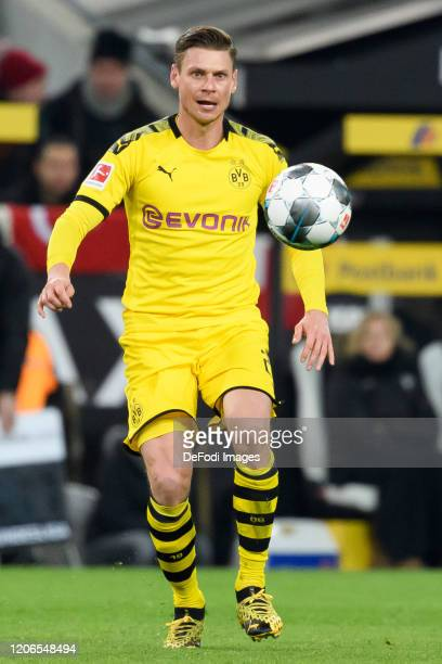 Lukasz Piszczek of Borussia Dortmund controls the ball during the Bundesliga match between Borussia Moenchengladbach and Borussia Dortmund at...