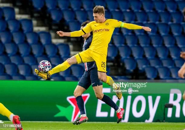 Lukasz Piszczek of Borussia Dortmund controls the ball during the UEFA Champions League round of 16 second leg match between Paris SaintGermain and...