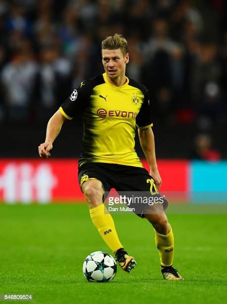 Lukasz Piszczek of Borussia Dortmund controls the ball during the UEFA Champions League group H match between Tottenham Hotspur and Borussia Dortmund...