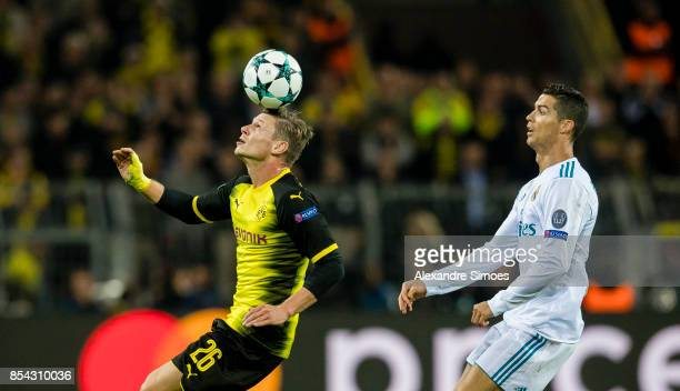 Lukasz Piszczek of Borussia Dortmund gets challenged by Christiano Ronaldo of Real Madrid during the UEFA Champions League First Qualifying Round 1st...