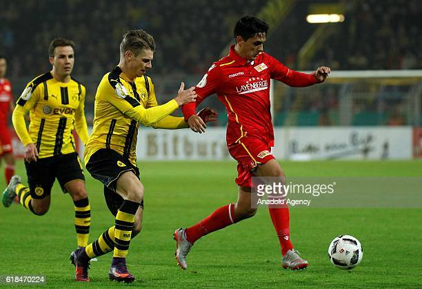 Lukasz Piszczek of Borussia Dortmund in action with Eroll Zejnullahu of 1FC Union Berlin during the DFB Pokal soccer match between Borussia Dortmund...