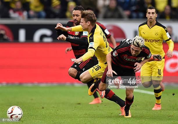 Lukasz Piszczek of Borussia Dortmund is challenged by Kevin Kampl of Bayer Leverkusen during the Bundesliga match between Bayer Leverkusen and...