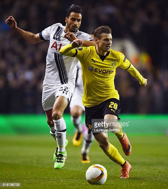Lukasz Piszczek of Borussia Dortmund is chased by Nacer Chadli of Tottenham Hotspur during the UEFA Europa League round of 16 second leg match...