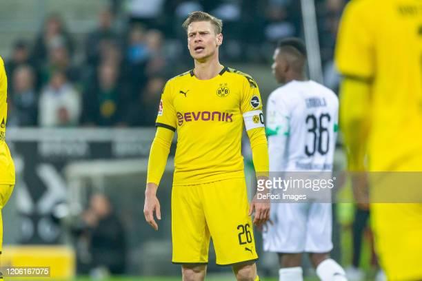Lukasz Piszczek of Borussia Dortmund looks dejected during the Bundesliga match between Borussia Moenchengladbach and Borussia Dortmund at...