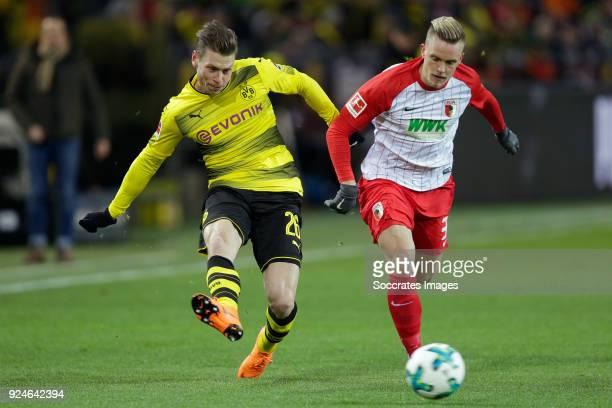 Lukasz Piszczek of Borussia Dortmund Martin Hinteregger of FC Augsburg during the German Bundesliga match between Borussia Dortmund v FC Augsburg at...