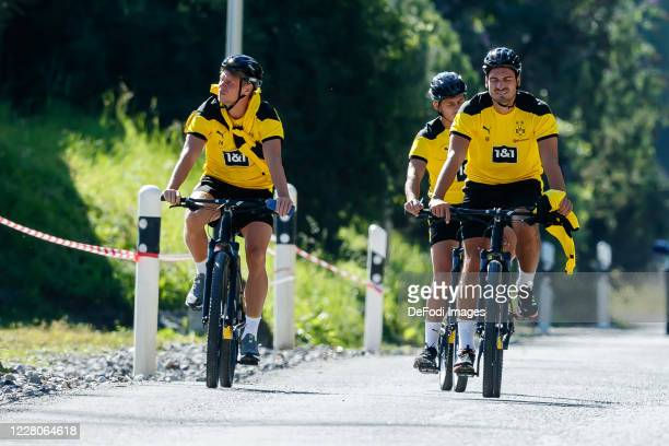 Lukasz Piszczek of Borussia Dortmund, Thorgan Hazard of Borussia Dortmund and Mats Hummels of Borussia Dortmund look on during day 6 of the...