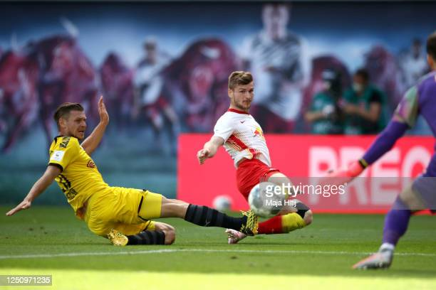 Lukasz Piszczek of Borussia Dortmund tries to block Timo Werner of RB Leipzig during the Bundesliga match between RB Leipzig and Borussia Dortmund at...