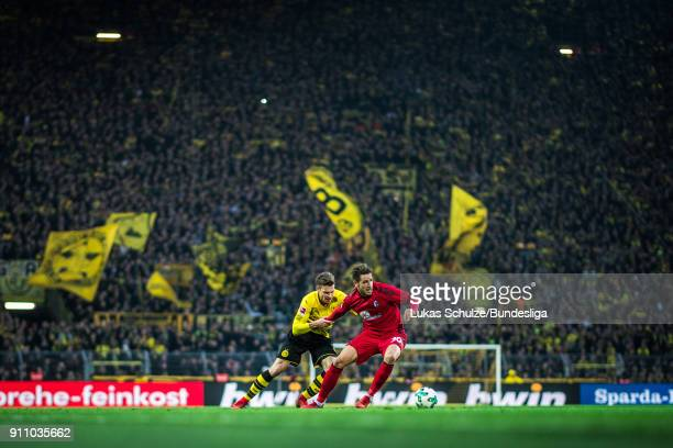 Lukasz Piszczek of Dortmund and Christian Guenter of Freiburg in action during the Bundesliga match between Borussia Dortmund and SportClub Freiburg...