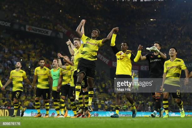 Lukasz Piszczek of Dortmund and DanAxel Zagadou of Dortmund and players of Dortmund celebrate with their fans after the Bundesliga match between...