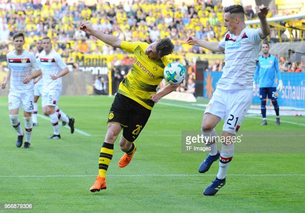 Lukasz Piszczek of Dortmund and Dominik Kohr of Leverkusen battle for the ball during the Bundesliga match between Borussia Dortmund and Bayer 04...