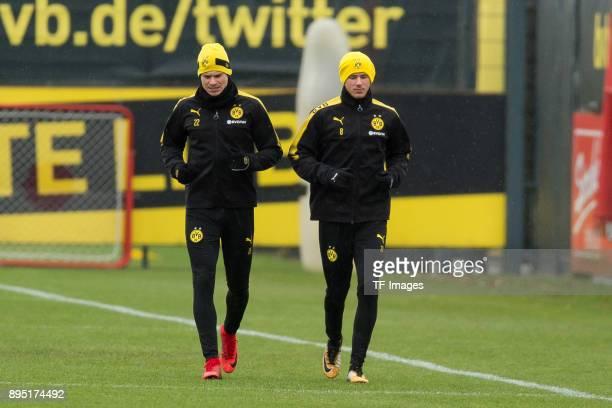 Lukasz Piszczek of Dortmund and Erik Durm of Dortmund walk during a training session at BVB trainings center on December 13 2017 in Dortmund