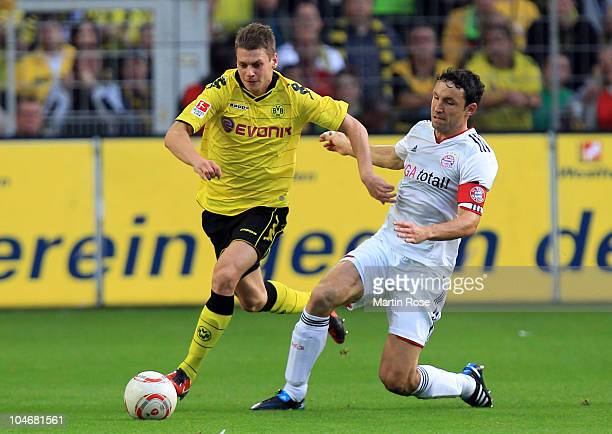 Lukasz Piszczek of Dortmund and Mark van Bommel of Muenchen battle for the ball during the Bundesliga match between Borussia Dortmund and FC Bayern...