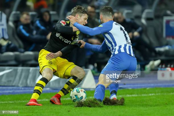 Lukasz Piszczek of Dortmund and Mathew Allan Leckie of Hertha battle for the ball during the Bundesliga match between Hertha BSC and Borussia...