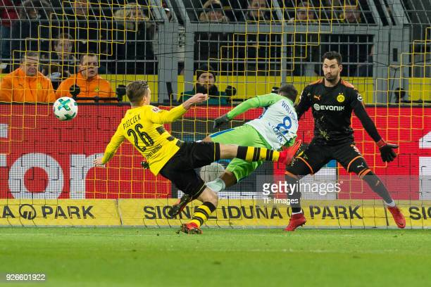 Lukasz Piszczek of Dortmund and Renato Steffen of Wolfsburg battle for the ball during the Bundesliga match between Borussia Dortmund and VfL...
