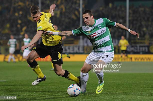 Lukasz Piszczek of Dortmund and Sercan Sararer of Fuerth battle for the ball during the DFB Cup semi final match between SpVgg Greuther Fuerth and...