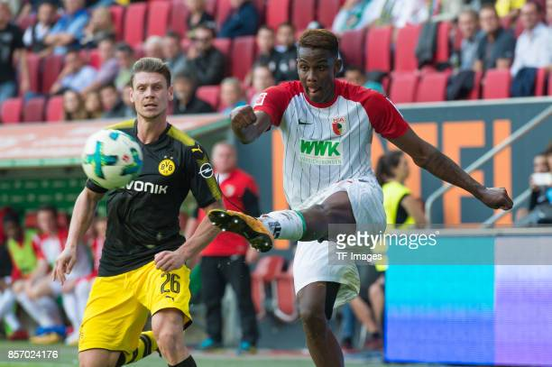Lukasz Piszczek of Dortmund and Sergio Cordova of Augsburg battle for the ball during the Bundesliga match between FC Augsburg and Borussia Dortmund...