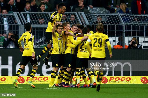 Lukasz Piszczek of Dortmund celebrates the second goal with his team mates during the Bundesliga match between Borussia Dortmund and Borussia...