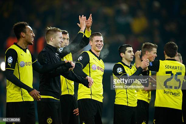 Lukasz Piszczek of Dortmund celebrates victory with team mates during the UEFA Champions League Group F match between Borussia Dortmund and SSC...
