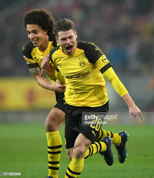 Lukasz Piszczek of Dortmund celebrates with teammate Axel Witsel of Dortmund after scoring his team's second goal during the Bundesliga match between...
