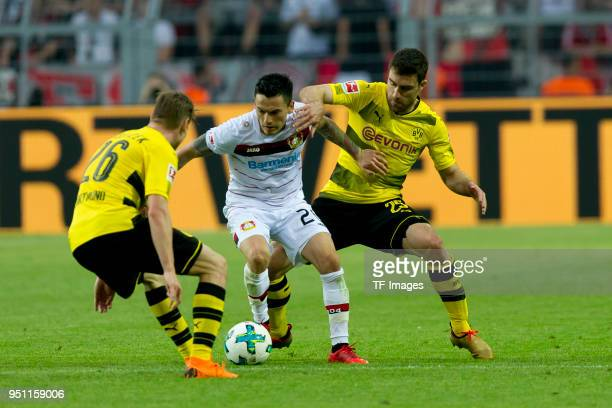 Lukasz Piszczek of Dortmund Dominik Kohr of Leverkusen and Sokratis Papastathopoulos of Dortmund battle for the ball during the Bundesliga match...