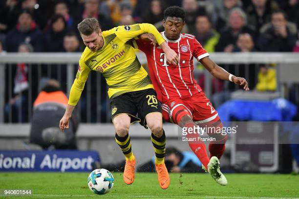 Lukasz Piszczek of Dortmund fights for the ball with David Alaba of Bayern Muenchen during the Bundesliga match between FC Bayern Muenchen and...