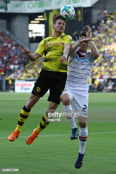 Lukasz Piszczek of Dortmund fights for the ball with Dominik Kohr of Bayer Leverkusen during the Bundesliga match between Borussia Dortmund and Bayer...