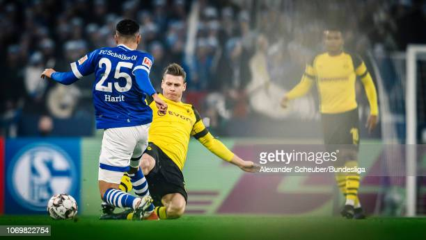 Lukasz Piszczek of Dortmund in action against Amine Harit of Schalke during the Bundesliga match between FC Schalke 04 and Borussia Dortmund at...
