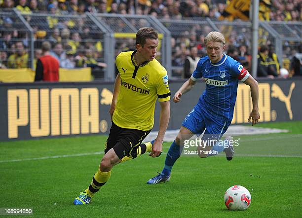 Lukasz Piszczek of Dortmund is challenged by Andreas Beck of Hoffenheim during the Bundesliga match between Borussia Dortmund and TSG 1899 Hoffenheim...