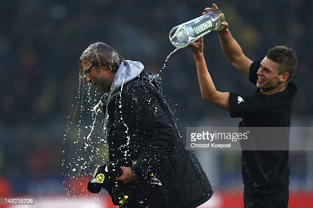 Lukasz Piszczek of Dortmund pours beer over head coach Juergen Klopp after winning 2-0 and the German Championships after the 1. Bundesliga match...