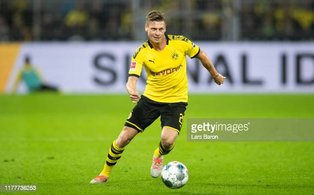 Lukasz Piszczek of Dortmund runs with the ball during the Bundesliga match between Borussia Dortmund and SV Werder Bremen at Signal Iduna Park on...