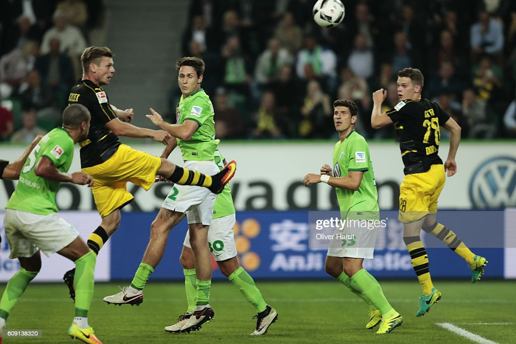 Lukasz Piszczek (L) of Dortmund scores their first goal with a header during the Bundesliga match between VfL Wolfsburg and Borussia Dortmund at Volkswagen Arena on September 20, 2016 in Wolfsburg, Germany.