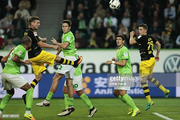 Lukasz Piszczek of Dortmund scores their first goal with a header during the Bundesliga match between VfL Wolfsburg and Borussia Dortmund at...