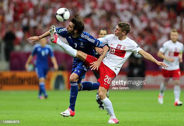 Lukasz Piszczek of Poland and Giorgos Samaras of Greece battle for the ball during the UEFA EURO 2012 group A match between Poland and Greece at...