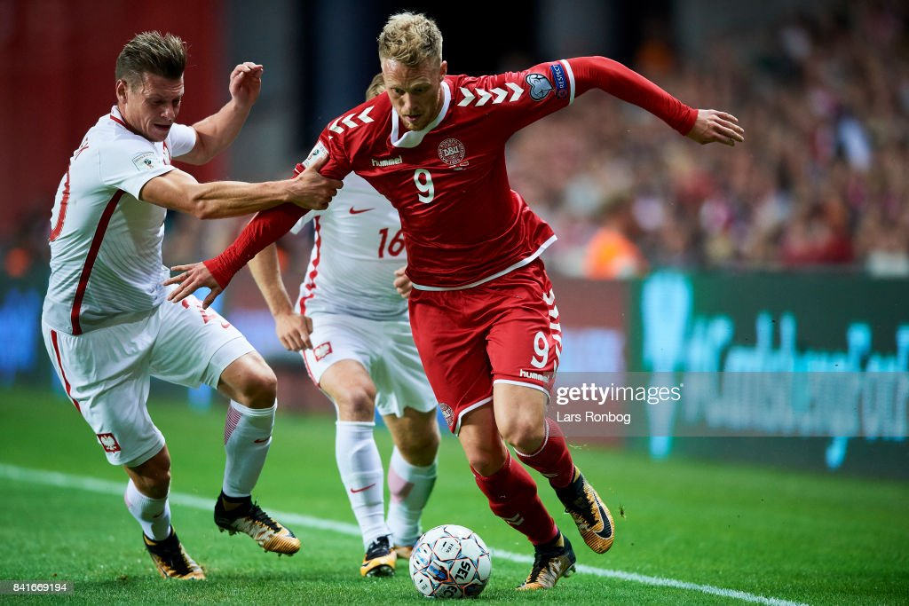 Lukasz Piszczek of Poland and Nicolai Jorgensen of Denmark compete for the ball during the FIFA World Cup 2018 qualifier match between Denmark and Poland at Telia Parken Stadium on September 1, 2017 in Copenhagen, Denmark.