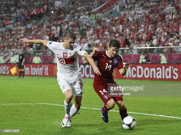Lukasz Piszczek of Poland and Vaclav Pilar of Czech Republic battle for the ball during the UEFA EURO 2012 group A match between Czech Republic and...