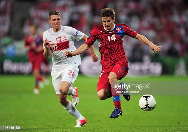 Lukasz Piszczek of Poland and Vaclav Pilar of Czech Republic compete for the ball during the UEFA EURO 2012 group A match between Czech Republic and...