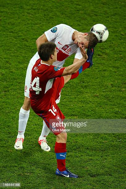 Lukasz Piszczek of Poland and Vaclav Pilar of Czech Republic fight for the ball during the UEFA EURO 2012 group A match between Czech Republic and...