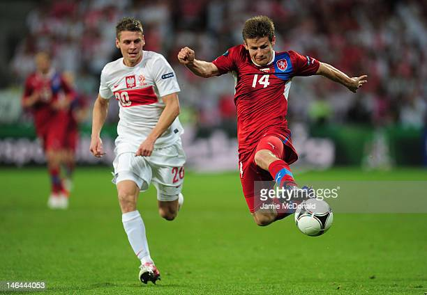 Lukasz Piszczek of Poland chases down Vaclav Pilar of Czech Republic during the UEFA EURO 2012 group A match between Czech Republic and Poland at The...