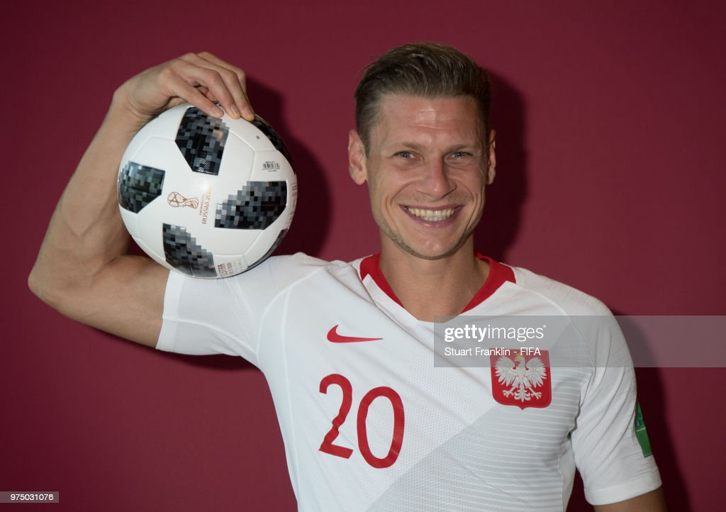 Lukasz Piszczek of Poland poses for a photograph during the official FIFA World Cup 2018 portrait session at on June 14, 2018 in Sochi, Russia.