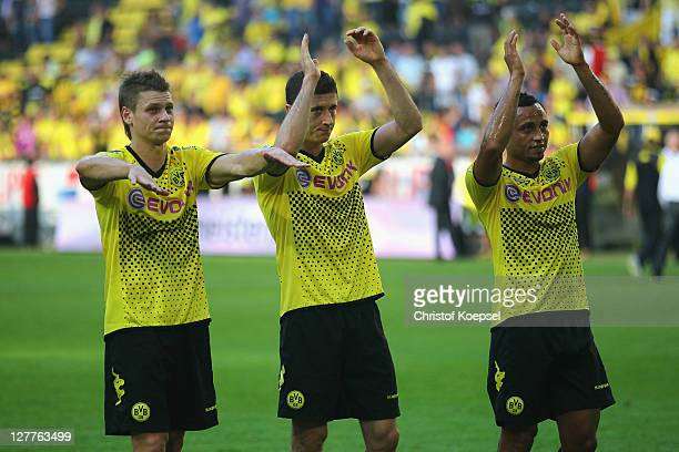 Lukasz Piszczek Robert Lewandowski and Antonio da Silva of Dortmund celebrate the 40 victory after the Bundesliga match between Borussia Dortmund and...