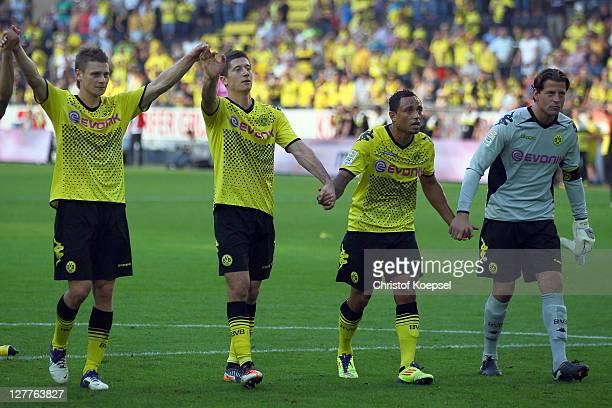 Lukasz Piszczek Robert Lewandowski Antonio da Silva and Roman Weidenfeller of Dortmund celebrate the 40 victory after the Bundesliga match between...