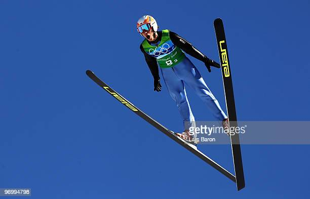 Lukasz Rutkowski of Poland competes in the men's ski jumping team event on day 11 of the 2010 Vancouver Winter Olympics at Whistler Olympic Park Ski...