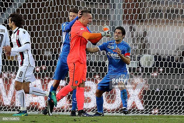Lukasz Skorupski of Empoli FC receives compliments from classmates after saving the penalty of Dos Santos Joao Pedro of Cagliari Calcio during the...