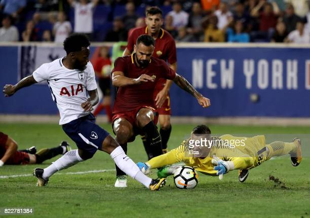 Lukasz Skorupski of Roma stops a shot by GeorgesKevin Nkoudou of Tottenham Hotspur but is unable to stop the rebound as Harry Winks of Tottenham...