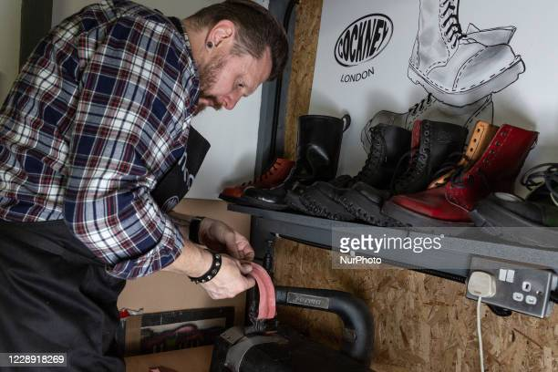 Lukasz Smiejekworks in his handmadeCockney boots workshop in London on October 5, 2020. Cockney Shoes produces fully hand made cockney styleand...