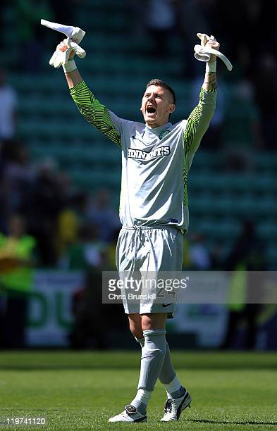 Lukasz Zaluska of Celtic celebrates at fulltime following the Clydesdale Bank Premier League match between Hibernian and Celtic at Easter Road on...