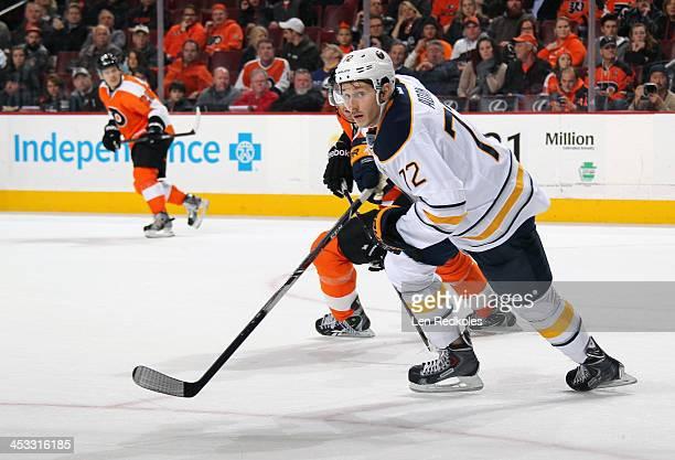 Luke Adam of the Buffalo Sabres skates against the Philadelphia Flyers on November 21 2013 at the Wells Fargo Center in Philadelphia Pennsylvania